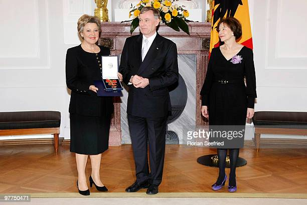 German President Horst Koehler and his wife Eva Luise Koehler and actress MarieLuise Marjan pose for a picture after she received the Federal Cross...