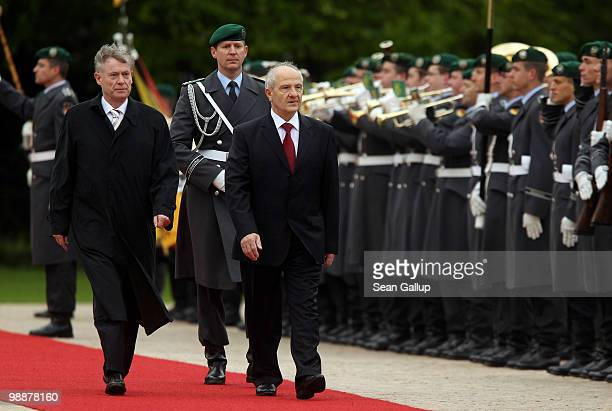 German President Horst Koehler and Kosovo President Fatmir Sejdiu review a guard of honour upon Sejdiu's arrival at Bellevue Palace on May 6 2010 in...