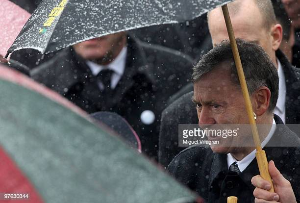 German President Horst Koehler is pictured underneath an umbrella during a commemoration ceremony in front of the Albertville School on March 11 2010...