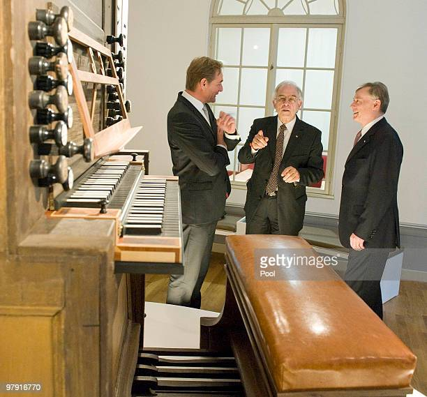 German President Horst Koehler mayor of Leipzig Burkhard Jung and director of the Bach Archive Christoph Wolff are seen behind the original console...