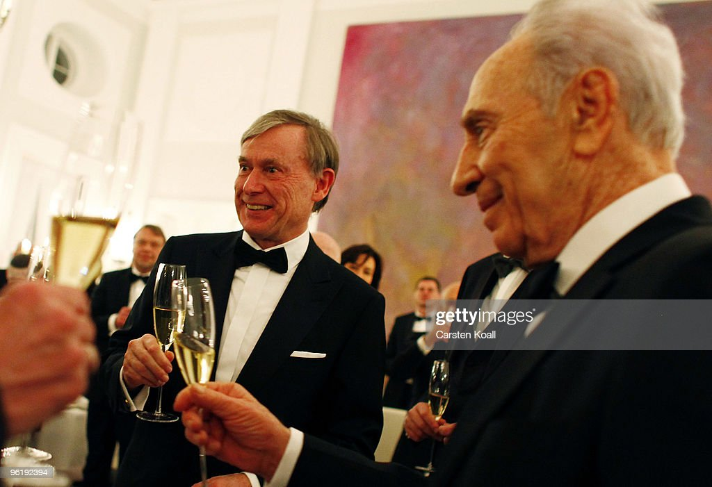 German President <a gi-track='captionPersonalityLinkClicked' href=/galleries/search?phrase=Horst+Koehler&family=editorial&specificpeople=209063 ng-click='$event.stopPropagation()'>Horst Koehler</a> toast at a gala dinner in honour to Israeli President <a gi-track='captionPersonalityLinkClicked' href=/galleries/search?phrase=Shimon+Peres&family=editorial&specificpeople=201775 ng-click='$event.stopPropagation()'>Shimon Peres</a> (R) on January 26, 2010 in Berlin, Germany. Peres is on a official four-day visit to Germany and will address the Bundestag lower house of Parliament.