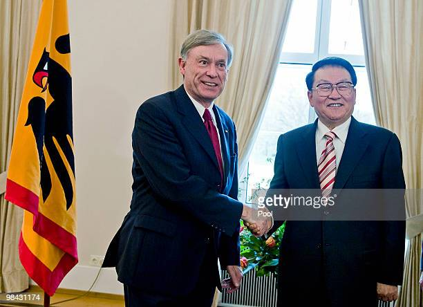 German president Horst Koehler welcomes Li Changchun a standing committee member of Chinese Communist Party's Political Bureau at Schloss Bellevue...