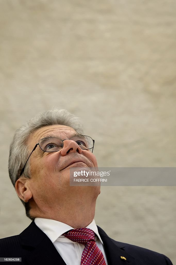 German President Joachim Gauck admires the ceiling painted by Spanish artist Miquel Barcelo prior to addressing the opening day of the 22nd session of the United Nations Human Rights Council on February 25, 2013 in Geneva. The Council kicks off with widespread abuses in North Korea and Mali the top items on the agenda, along with the crisis in Syria.