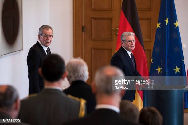 German President Joachim Gauck and Austrian President Alexander van der Bellen arrive to a joint press conference at the Bellevue presidential palace...