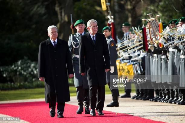 German President Joachim Gauck and Austrian President Alexander van der Bellen review the guard of honour at the Bellevue presidential palace in...