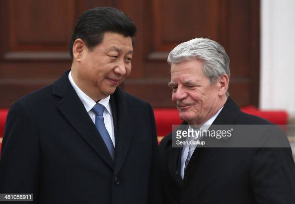 German President Joachim Gauck and Chinese President Xi Jinping chat upon President Xi Jinping's arrival at Schloss Bellevue on March 28 2014 in...