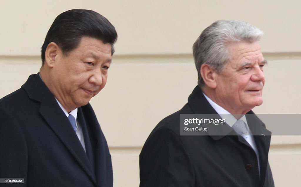 German President <a gi-track='captionPersonalityLinkClicked' href=/galleries/search?phrase=Joachim+Gauck&family=editorial&specificpeople=2077888 ng-click='$event.stopPropagation()'>Joachim Gauck</a> (R) and Chinese President <a gi-track='captionPersonalityLinkClicked' href=/galleries/search?phrase=Xi+Jinping&family=editorial&specificpeople=2598986 ng-click='$event.stopPropagation()'>Xi Jinping</a> prepare to review a guard of honour upon President <a gi-track='captionPersonalityLinkClicked' href=/galleries/search?phrase=Xi+Jinping&family=editorial&specificpeople=2598986 ng-click='$event.stopPropagation()'>Xi Jinping</a>'s arrival at Schloss Bellevue on March 28, 2014 in Berlin, Germany. President <a gi-track='captionPersonalityLinkClicked' href=/galleries/search?phrase=Xi+Jinping&family=editorial&specificpeople=2598986 ng-click='$event.stopPropagation()'>Xi Jinping</a> is on a two-day official visit to Germany.