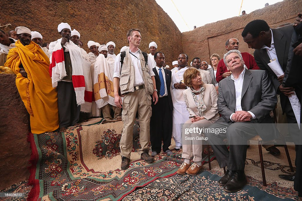 German President Joachim Gauck and First Lady Daniela Schadt arrive to observe Ethiopian Orthodox clergy perform a ritual celebrating the Virgin Mary outside St. Mary's Church on March 19, 2013 in Lalibela, Ethiopia. Lalibela is among Ethiopia's holiest of cities and is distinguished by its 11 churches hewn into solid rock dating back to the 12th century. President Gauck and First Lady Daniela Schadt are on the third of a four-day state visit to Ethiopia.