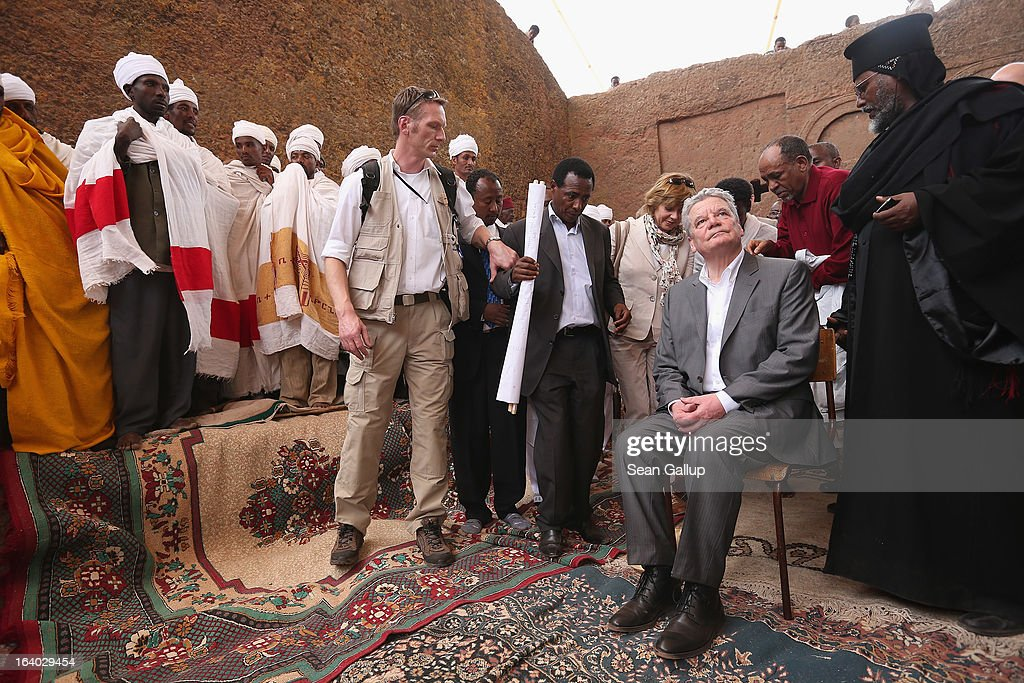 German President Joachim Gauck and First Lady Daniela Schadt arrive to observe Ethiopian Orthodox clergy perform a ritual celebrating the Virgin Mary outside St. Mary's Church on March 19, 2013 in Lalibela, Ethiopia. Lalibela is among Ethiopia's holiest of cities and is distinguished by its 11 churches hewn into solid rock. President Gauck and First Lady Daniela Schadt are on the third of a four-day state visit to Ethiopia.
