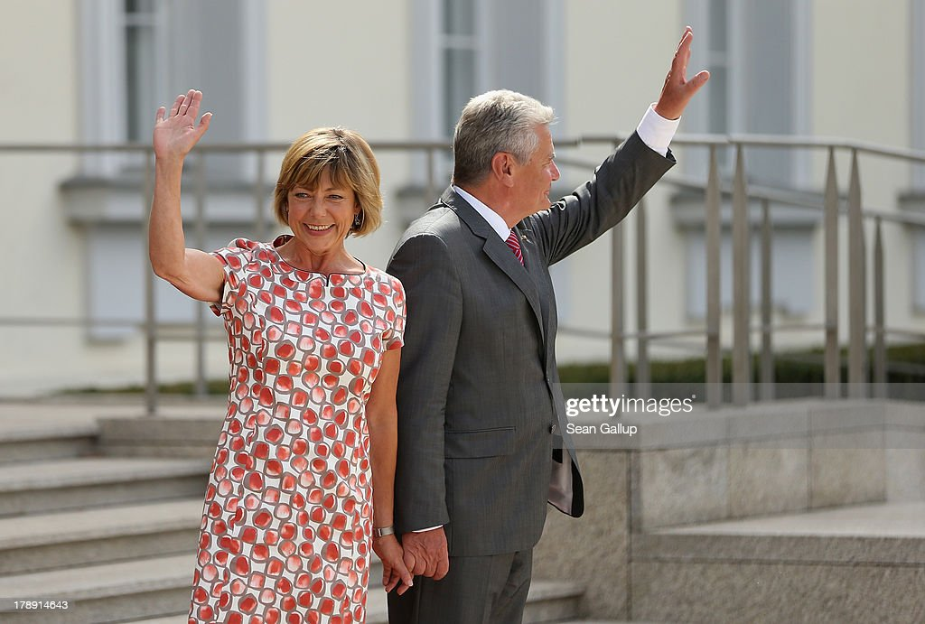 German President <a gi-track='captionPersonalityLinkClicked' href=/galleries/search?phrase=Joachim+Gauck&family=editorial&specificpeople=2077888 ng-click='$event.stopPropagation()'>Joachim Gauck</a> and First Lady <a gi-track='captionPersonalityLinkClicked' href=/galleries/search?phrase=Daniela+Schadt&family=editorial&specificpeople=7055235 ng-click='$event.stopPropagation()'>Daniela Schadt</a> greet visitors at the annual Citizens' Fest at Bellevue Palace on August 31, 2013 in Berlin, Germany. The annual fest opens the palace grounds to visitors honored for their projects and initiatives in order to stress the president's office's support for citizen engagement.