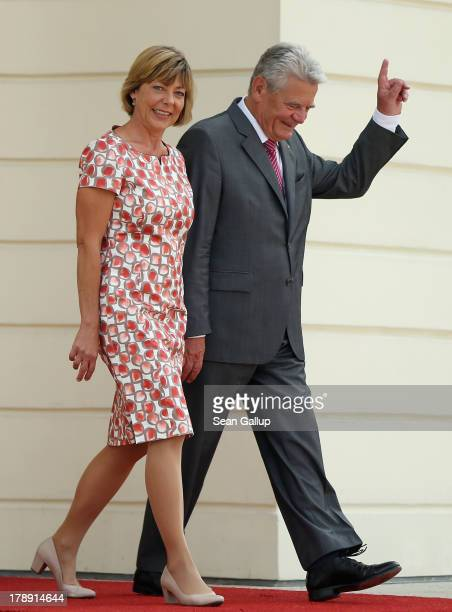 German President Joachim Gauck and First Lady Daniela Schadt greet visitors at the annual Citizens' Fest at Bellevue Palace on August 31 2013 in...