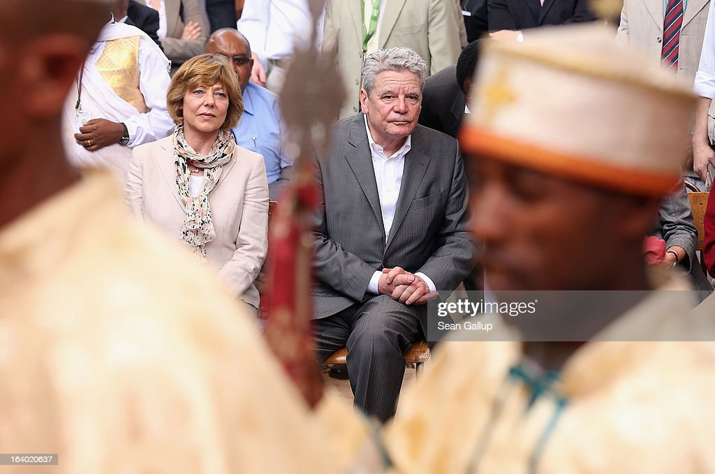 German President Joachim Gauck and First Lady Daniela Schadt observe Ethiopian Orthodox clergy perform a ritual celebrating the Virgin Mary outside St. Mary's Church on March 19, 2013 in Lalibela, Ethiopia. Lalibela is among Ethiopia's holiest of cities and is distinguished by its 11 churches hewn into solid rock that date back to the 12th century. President Gauck and First Lady Daniela Schadt are on the third of a four-day state visit to Ethiopia.