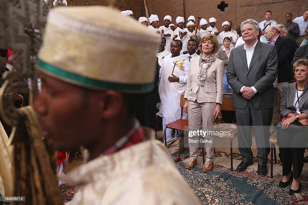German President Joachim Gauck and First Lady Daniela Schadt observe Ethiopian Orthodox clergy perform a ritual celebrating the Virgin Mary outside St. Mary's Church on March 19, 2013 in Lalibela, Ethiopia. Lalibela is among Ethiopia's holiest of cities and is distinguished by its 11 churches hewn into solid rock. President Gauck and First Lady Daniela Schadt are on the third of a four-day state visit to Ethiopia.