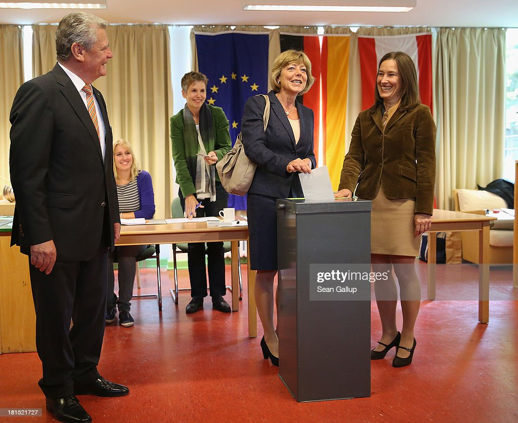 German President Joachim Gauck (L) and his partner Daniela Schadt (2nd from R) cast their ballots in German federal elections on September 22, 2013 in Berlin, Germany. Germany is holding federal elections that will determine whether current Chancellor Angela Merkel of the German Christian Democrats (CDU) will remain for a third term. Though the CDU has a strong lead over the opposition, speculations run wide as to what coalition will be viable in coming weeks to create a new government.