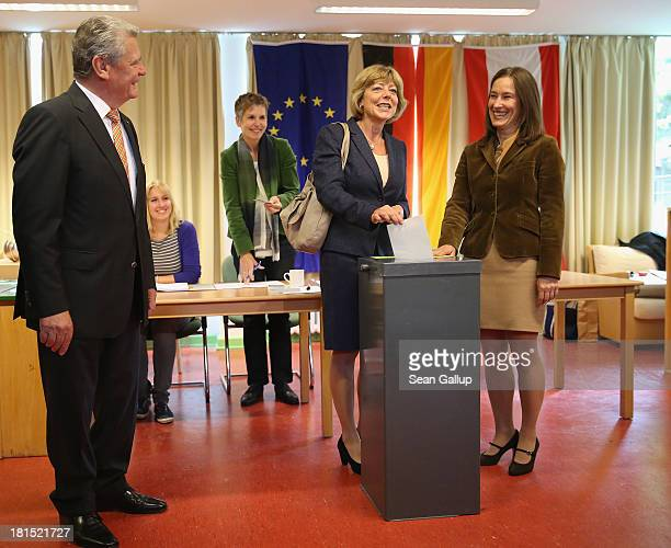 German President Joachim Gauck and his partner Daniela Schadt cast their ballots in German federal elections on September 22 2013 in Berlin Germany...