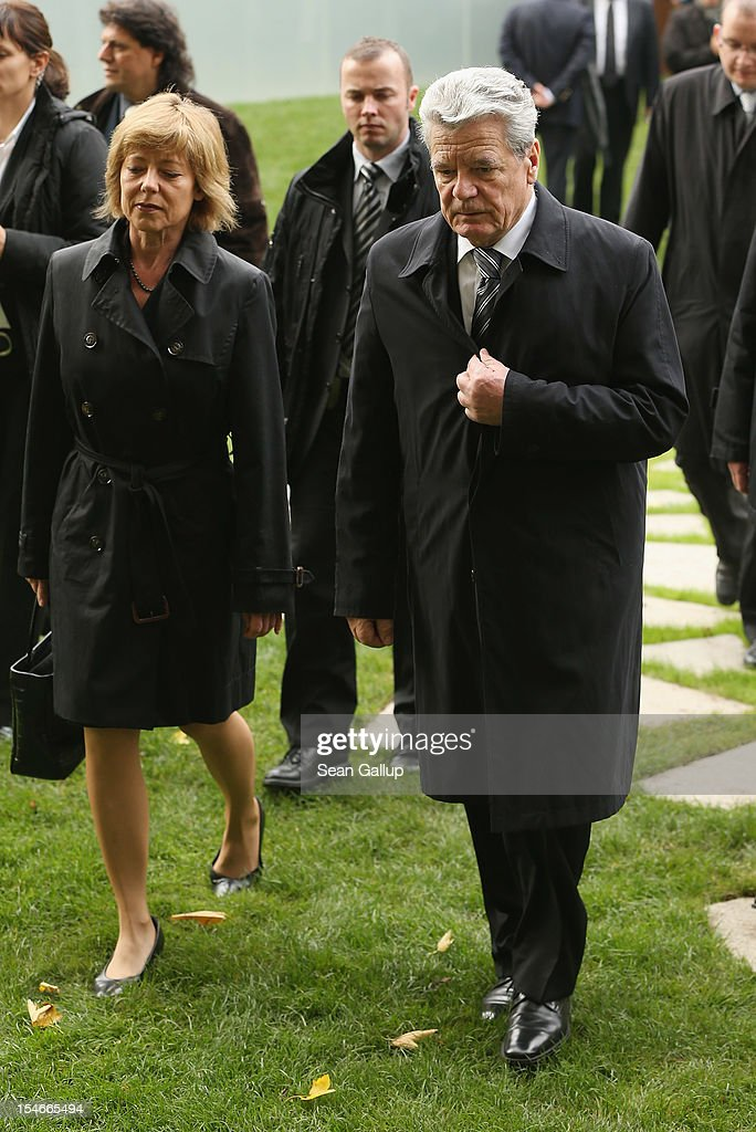 """German President <a gi-track='captionPersonalityLinkClicked' href=/galleries/search?phrase=Joachim+Gauck&family=editorial&specificpeople=2077888 ng-click='$event.stopPropagation()'>Joachim Gauck</a> and his partner Daniela Schadt depart after attending the inauguration of the """"Memorial to the Sinti and Roma of Europe Murdered Under National Socialism"""" on October 24, 2012 in Berlin, Germany. In addition to targeting Jews during the Holocaust, Hitler also sought to exterminate the Roma population in Europe and estimates of the number killed range from 220,000 to 1,500,000."""