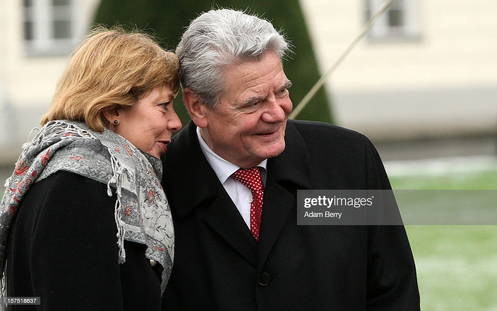 German President Joachim Gauck (R) and his partner Daniela Schadt listen to Christmas carols being sung by students of the Carl von Ossietzky school during the illumination ceremony for the Christmas tree at Bellevue Presidential Palace on December 4, 2012 in Berlin, Germany. The 12-meter (40-foot) tall Colorado blue spruce (Picea pungens) was planted in 1994 and is being supplied to the president for the second time by Werderaner Tannenhof Christmas tree farm in the town of Werder, just outside of the German capital.