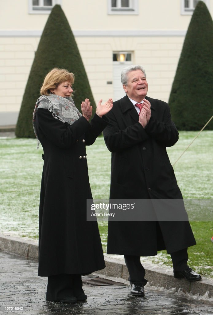 German President <a gi-track='captionPersonalityLinkClicked' href=/galleries/search?phrase=Joachim+Gauck&family=editorial&specificpeople=2077888 ng-click='$event.stopPropagation()'>Joachim Gauck</a> (R) and his partner Daniela Schadt listen to Christmas carols being sung by students of the Carl von Ossietzky school during the illumination ceremony for the Christmas tree at Bellevue Presidential Palace on December 4, 2012 in Berlin, Germany. The 12-meter (40-foot) tall Colorado blue spruce (Picea pungens) was planted in 1994 and is being supplied to the president for the second time by Werderaner Tannenhof Christmas tree farm in the town of Werder, just outside of the German capital.