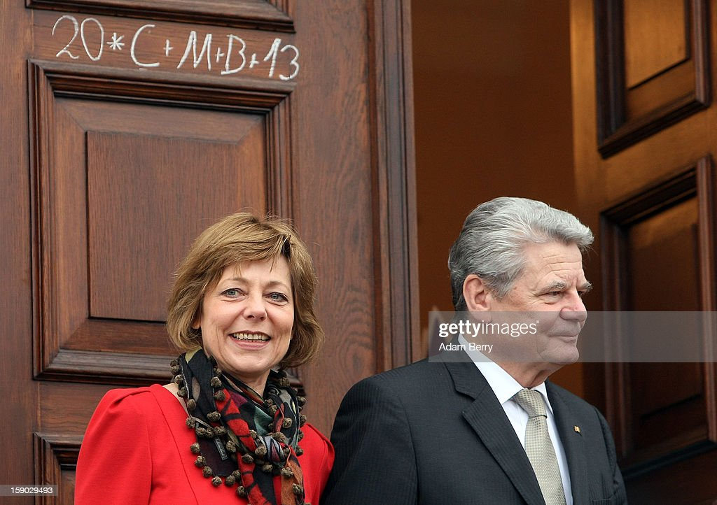 German President <a gi-track='captionPersonalityLinkClicked' href=/galleries/search?phrase=Joachim+Gauck&family=editorial&specificpeople=2077888 ng-click='$event.stopPropagation()'>Joachim Gauck</a> (R) and his partner, <a gi-track='captionPersonalityLinkClicked' href=/galleries/search?phrase=Daniela+Schadt&family=editorial&specificpeople=7055235 ng-click='$event.stopPropagation()'>Daniela Schadt</a>, listen to Child Epiphany carolers, known as Sternsinger in German, during their visit to Bellevue presidential palace on January 6, 2013 in Berlin, Germany, while standing under the letters C M B (Latin for christus mansionem benedicat = Christ bless this house) and the year 2013, written by the carolers in chalk. The children walk from house to house in the days around January 6, singing carols and collecting money for needy children around the world, dressed as the Three Magi of the Christmas story in the Gospel of Matthew.