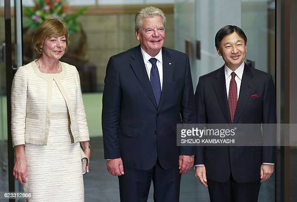 German President Joachim Gauck and his partner Daniela Schadt pose with Japanese Crown Prince Naruhito at Togu Palace in Tokyo on November 15 2016 /...