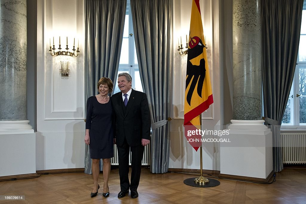 German President Joachim Gauck (R) and his partner Daniela Schadt (L) prepare to greet guests during an annual New Year reception at the Presidential Palace in Berlin January 10, 2013.