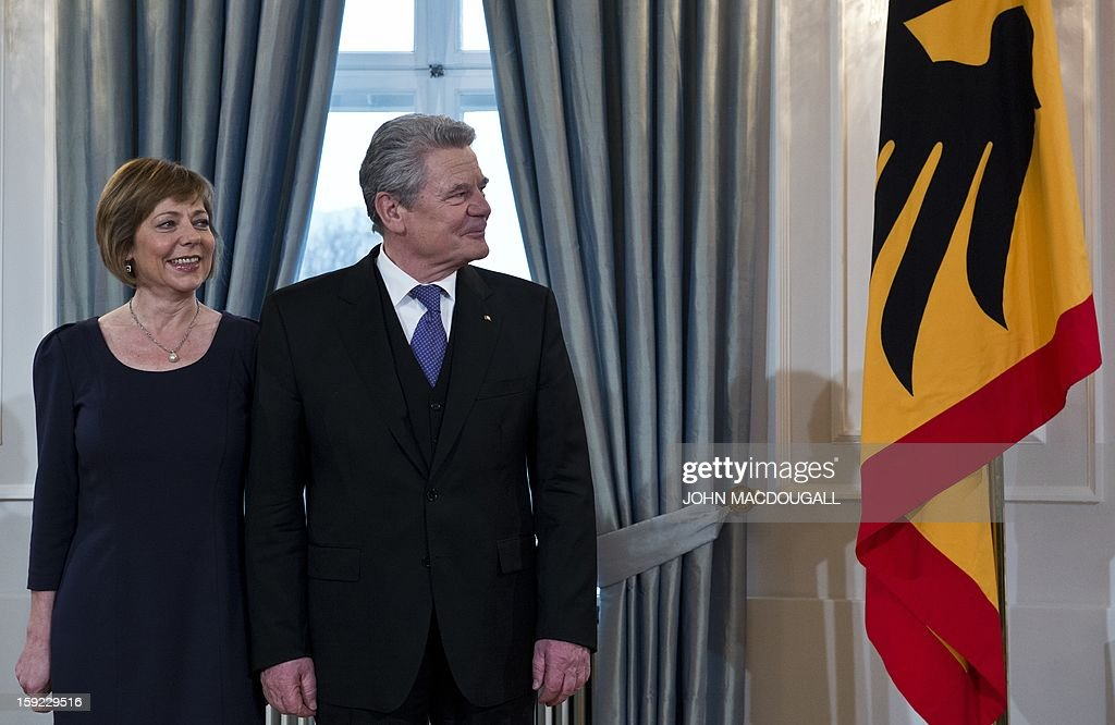 German President Joachim Gauck (R) and his partner Daniela Schadt (L) prepare to greet guests during an annual New Year reception at the Presidential Palace in Berlin January 10, 2013. AFP PHOTO / JOHN MACDOUGALL
