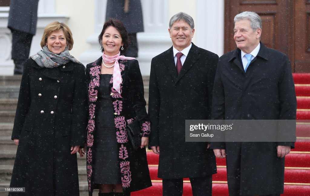 German President <a gi-track='captionPersonalityLinkClicked' href=/galleries/search?phrase=Joachim+Gauck&family=editorial&specificpeople=2077888 ng-click='$event.stopPropagation()'>Joachim Gauck</a> (R) and his partner <a gi-track='captionPersonalityLinkClicked' href=/galleries/search?phrase=Daniela+Schadt&family=editorial&specificpeople=7055235 ng-click='$event.stopPropagation()'>Daniela Schadt</a> (L) welcome Kyrgyz President Almaz Atambayev and his wife Raisa Atambayeva at Schloss Bellevue presidential palace on December 11, 2012 in Berlin, Germany. Atambayev is in Berlin to promote the political and economic ties between Germany and Kyrgyzstan.