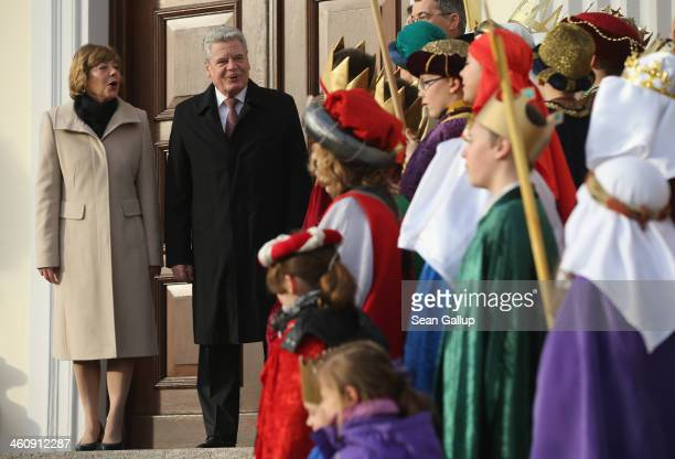 German President Joachim Gauck and his partner Daniela Schadt welcome children Epiphany carolers dressed as the Three Kings at Schloss Bellevue...