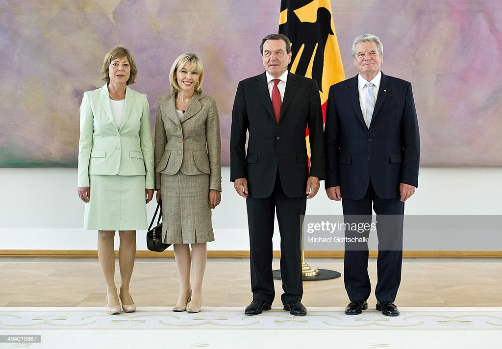 German President <a gi-track='captionPersonalityLinkClicked' href=/galleries/search?phrase=Joachim+Gauck&family=editorial&specificpeople=2077888 ng-click='$event.stopPropagation()'>Joachim Gauck</a> (R) and his partner <a gi-track='captionPersonalityLinkClicked' href=/galleries/search?phrase=Daniela+Schadt&family=editorial&specificpeople=7055235 ng-click='$event.stopPropagation()'>Daniela Schadt</a> (L) welcome former German chancellor Gerhard Schroeder and his wife <a gi-track='captionPersonalityLinkClicked' href=/galleries/search?phrase=Doris+Schroeder-Koepf&family=editorial&specificpeople=224024 ng-click='$event.stopPropagation()'>Doris Schroeder-Koepf</a> for a reception in Bellevue Castle (Schloss Bellevue) on the occasion of Schroeders 70th birthday on May 27, 2014 in Berlin, Germany.