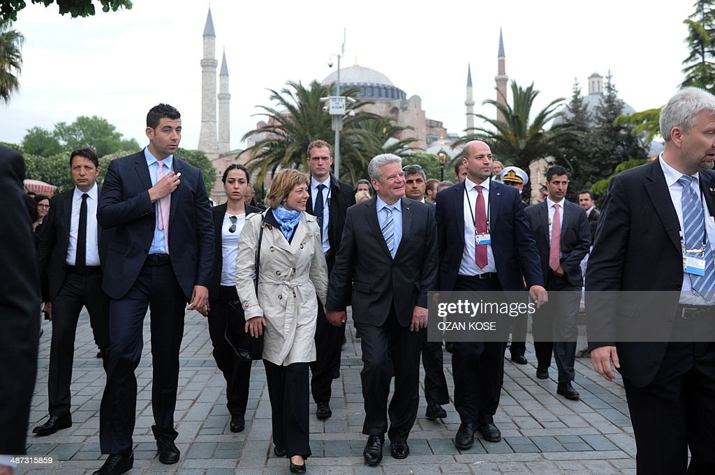 German president <a gi-track='captionPersonalityLinkClicked' href=/galleries/search?phrase=Joachim+Gauck&family=editorial&specificpeople=2077888 ng-click='$event.stopPropagation()'>Joachim Gauck</a> (C, R) and his partner partner Daniela Schadt (C, L) leave after visiting the Hagia Sofia Museum as part of Gauck's four-day visit to Turkey on April 29, 2014, in Istanbul. AFP PHOTO / OZAN KOSE