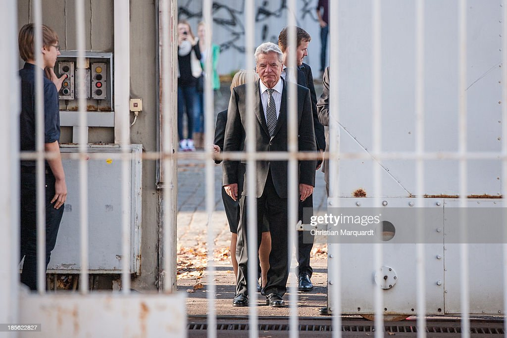 German President <a gi-track='captionPersonalityLinkClicked' href=/galleries/search?phrase=Joachim+Gauck&family=editorial&specificpeople=2077888 ng-click='$event.stopPropagation()'>Joachim Gauck</a> and Hubertus Knabe, Director of the Memoral 'Gedenkenstaette Berlin Hohenschoenhausen' enter the Memoral on October 22, 2013 in Berlin, Germany. 'Hohenschoenhausen' was the remand prison for people detained by the former East German Ministry for State Security (MfS) or 'Stasi' and has been a Memoral since 1994.