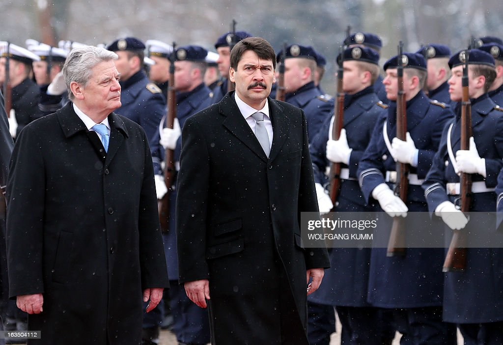 German President Joachim Gauck (L) and Hungarian President Janos Ader (R) review a guard of honour at the presidential Bellevue palace in Berlin, Germany on March 11, 2013. President Ader arrived for an official state visit of several days. OUT