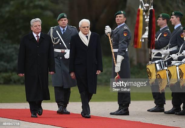 German President Joachim Gauck and Italian President Sergio Mattarella review a guard of honour upon Mattarella's arrival at Schloss Bellevue palace...