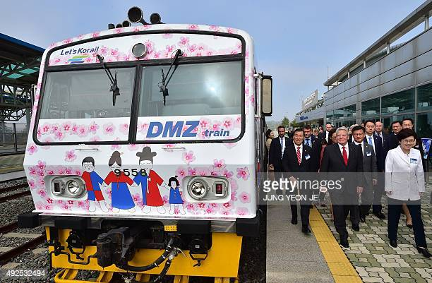 German President Joachim Gauck and Korea Railroad Corporation CEO Choi YeonHye walk past a DMZ train during the opening ceremony of the Unification...