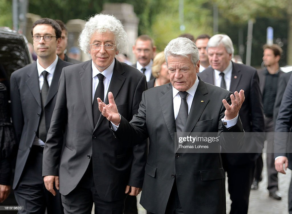 German President <a gi-track='captionPersonalityLinkClicked' href=/galleries/search?phrase=Joachim+Gauck&family=editorial&specificpeople=2077888 ng-click='$event.stopPropagation()'>Joachim Gauck</a> (R) and Marcel Reich-Ranicki's son Andrew Ranicki (L) after the funeral service for the literary critic Marcel Reich-Ranicki (1920 - 2013) on September 26, 2013 in Frankfurt am Main, Germany.