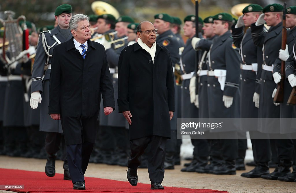 German President Joachim Gauck (L) and Tunisian President Moncef Marzouki review a gaud of honour upon Marzouki's arrival at Bellevue Palace on March 21, 2013 in Berlin, Germany. Marzouki is on a two-day state visit to Germany and is scheduled to meet with German Chancellor Angela Merkel tomorrow.