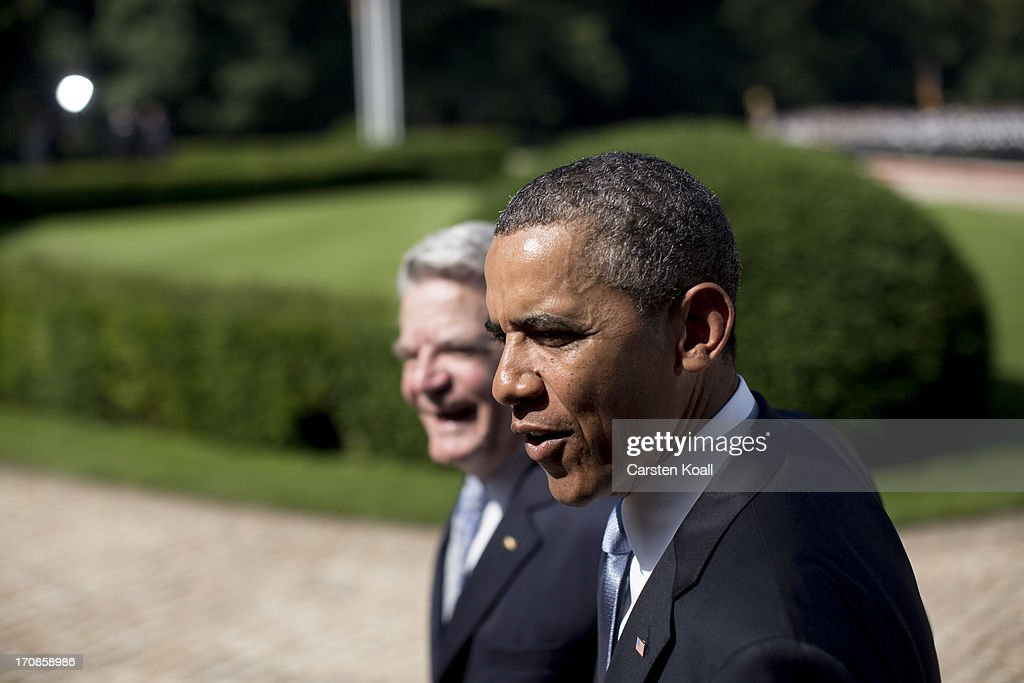 German President Joachim Gauck (L) and U.S. President Barack Obama (R) walk after reviewing a guard of honour at Schloss Bellevue presidential palace on June 19, 2013 in Berlin, Germany. Obama is visiting Berlin for the first time during his presidency and his speech at the Brandenburg Gate is to be the highlight. Obama will be speaking close to the 50th anniversary of the historic speech by then U.S. President John F. Kennedy in Berlin in 1963, during which he proclaimed the famous sentence: ÒIch bin ein Berliner.Ó