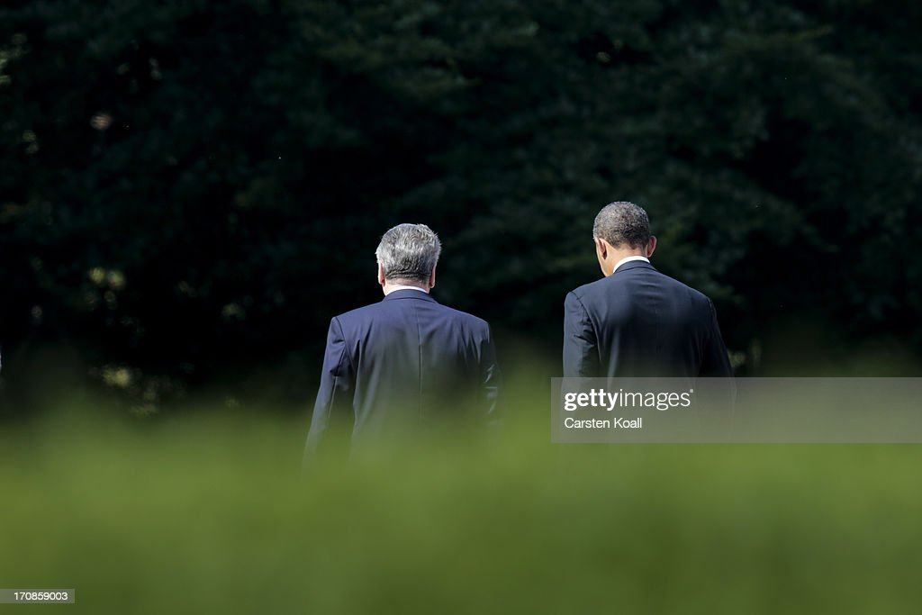 German President Joachim Gauck (L) and U.S. President Barack Obama (R) walk to review a guard of honour at Schloss Bellevue presidential palace on June 19, 2013 in Berlin, Germany. Obama is visiting Berlin for the first time during his presidency and his speech at the Brandenburg Gate is to be the highlight. Obama will be speaking close to the 50th anniversary of the historic speech by then U.S. President John F. Kennedy in Berlin in 1963, during which he proclaimed the famous sentence: ÒIch bin ein Berliner.Ó