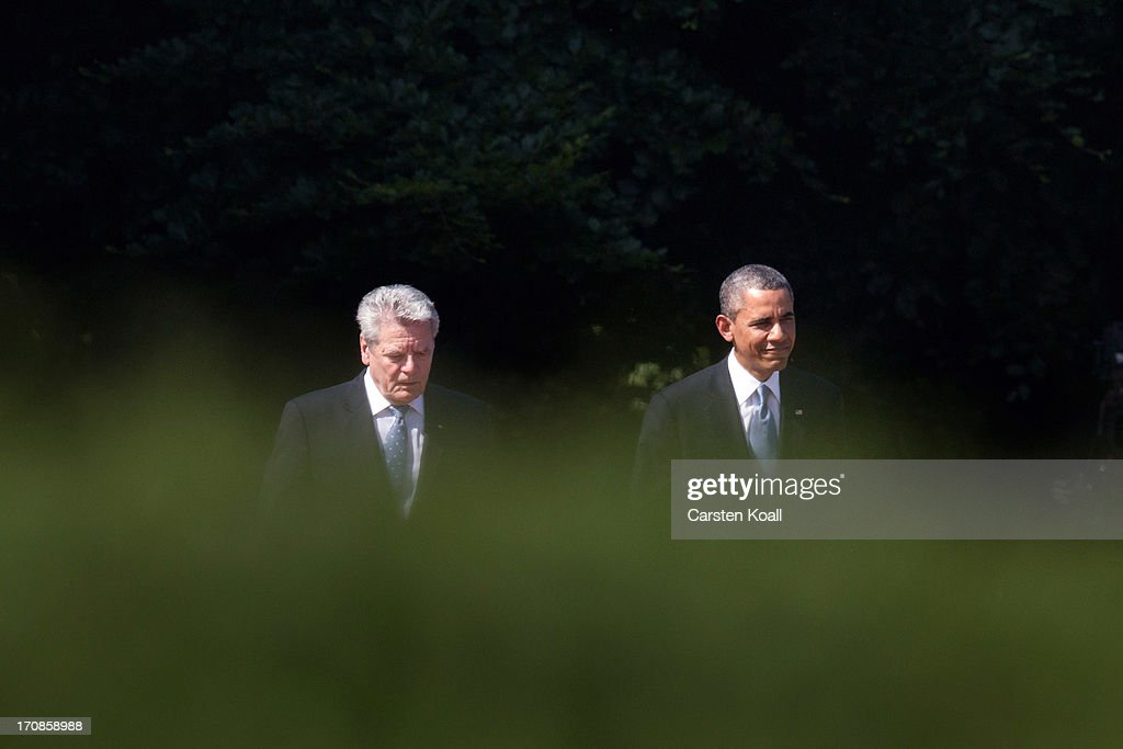 German President Joachim Gauck (L) and U.S. PUS-President Barack Obama (R walk to review a guard of honour at Schloss Bellevue presidential palace on June 19, 2013 in Berlin, Germany. Obama is visiting Berlin for the first time during his presidency and his speech at the Brandenburg Gate is to be the highlight. Obama will be speaking close to the 50th anniversary of the historic speech by then U.S. President John F. Kennedy in Berlin in 1963, during which he proclaimed the famous sentence: ÒIch bin ein Berliner.Ó