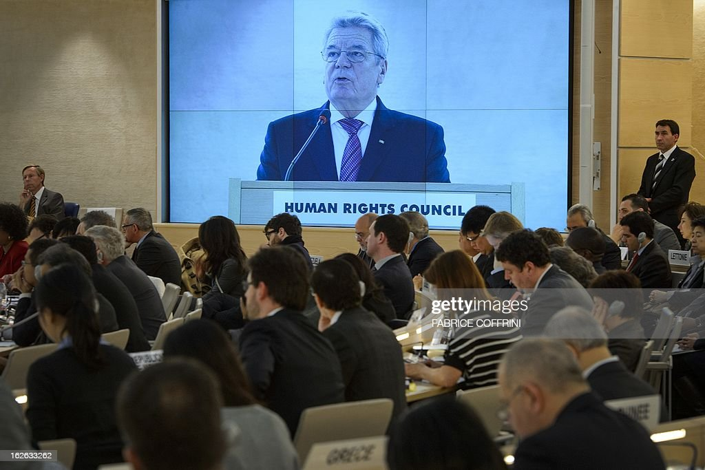 German President Joachim Gauck appears on a giant screen while addressing the opening day of the 22nd session of the United Nations Human Rights Council on February 25, 2013 in Geneva. The Council kicks off with widespread abuses in North Korea and Mali the top items on the agenda, along with the crisis in Syria. AFP PHOTO / FABRICE COFFRINI