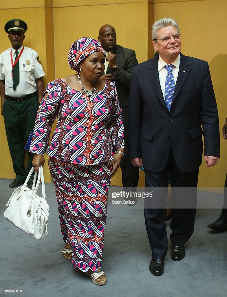 German President Joachim Gauck arrives with African Union (AU) Commission Chairwoman Nkosazana Dlamini-Zuma (R) to speak on the occasion of the upcoming 50th anniversary of the Organizaiton of African Unity, the predecessor to the AU, at the AU main plenary hall on the second day of his official visit on March 18, 2013 in Addis Ababa, Ethiopia. President Gauck and First Lady Daniela Schadt are in Ethiopia for a four-day state visit.