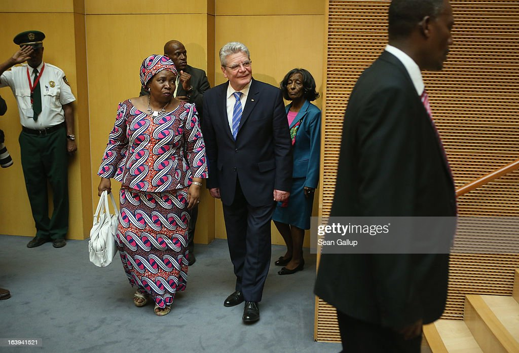 German President <a gi-track='captionPersonalityLinkClicked' href=/galleries/search?phrase=Joachim+Gauck&family=editorial&specificpeople=2077888 ng-click='$event.stopPropagation()'>Joachim Gauck</a> arrives with African Union (AU) Commission Chairwoman <a gi-track='captionPersonalityLinkClicked' href=/galleries/search?phrase=Nkosazana+Dlamini-Zuma&family=editorial&specificpeople=752696 ng-click='$event.stopPropagation()'>Nkosazana Dlamini-Zuma</a> (R) to speak on the occasion of the upcoming 50th anniversary of the Organizaiton of African Unity, the predecessor to the AU, at the AU main plenary hall on the second day of his official visit on March 18, 2013 in Addis Ababa, Ethiopia. President Gauck and First Lady Daniela Schadt are in Ethiopia for a four-day state visit.