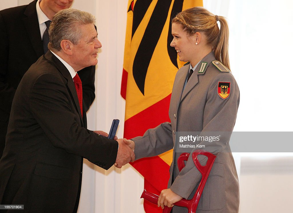 German President <a gi-track='captionPersonalityLinkClicked' href=/galleries/search?phrase=Joachim+Gauck&family=editorial&specificpeople=2077888 ng-click='$event.stopPropagation()'>Joachim Gauck</a> (L) awards Germany's bronze medalist of the woman's taekwondo under 67kg category <a gi-track='captionPersonalityLinkClicked' href=/galleries/search?phrase=Helena+Fromm&family=editorial&specificpeople=5500016 ng-click='$event.stopPropagation()'>Helena Fromm</a> (R) the Silbernes Lorbeerblatt during the 'Silbernes Lorbeerblatt Award Ceremony' at Schloss Bellevue on November 7, 2012 in Berlin, Germany.
