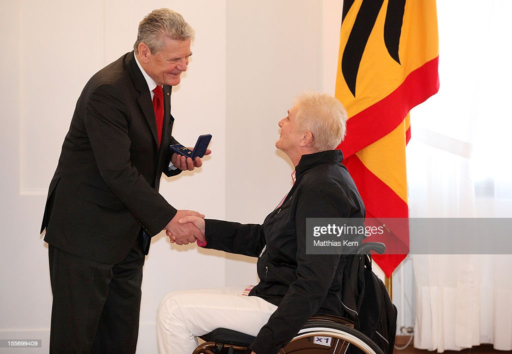 German President <a gi-track='captionPersonalityLinkClicked' href=/galleries/search?phrase=Joachim+Gauck&family=editorial&specificpeople=2077888 ng-click='$event.stopPropagation()'>Joachim Gauck</a> (L) awards Germany's silver medalist of the woman's shot put Marianne Buggenhagen (R) the Silbernes Lorbeerblatt during the 'Silbernes Lorbeerblatt Award Ceremony' at Schloss Bellevue on November 7, 2012 in Berlin, Germany.
