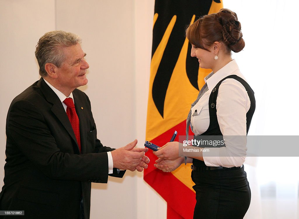 German President <a gi-track='captionPersonalityLinkClicked' href=/galleries/search?phrase=Joachim+Gauck&family=editorial&specificpeople=2077888 ng-click='$event.stopPropagation()'>Joachim Gauck</a> (L) awards Germany's silver medalist of the woman's 100m breaststroke Elena Krawzow (R) the Silbernes Lorbeerblatt during the 'Silbernes Lorbeerblatt Award Ceremony' at Schloss Bellevue on November 7, 2012 in Berlin, Germany.