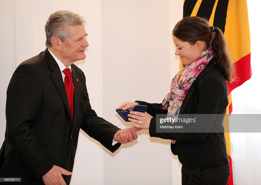 German President <a gi-track='captionPersonalityLinkClicked' href=/galleries/search?phrase=Joachim+Gauck&family=editorial&specificpeople=2077888 ng-click='$event.stopPropagation()'>Joachim Gauck</a> (L) awards Germany's silver medalist of the individual dressage <a gi-track='captionPersonalityLinkClicked' href=/galleries/search?phrase=Kristina+Sprehe&family=editorial&specificpeople=9167861 ng-click='$event.stopPropagation()'>Kristina Sprehe</a> (R) the Silbernes Lorbeerblatt during the 'Silbernes Lorbeerblatt Award Ceremony' at Schloss Bellevue on November 7, 2012 in Berlin, Germany.