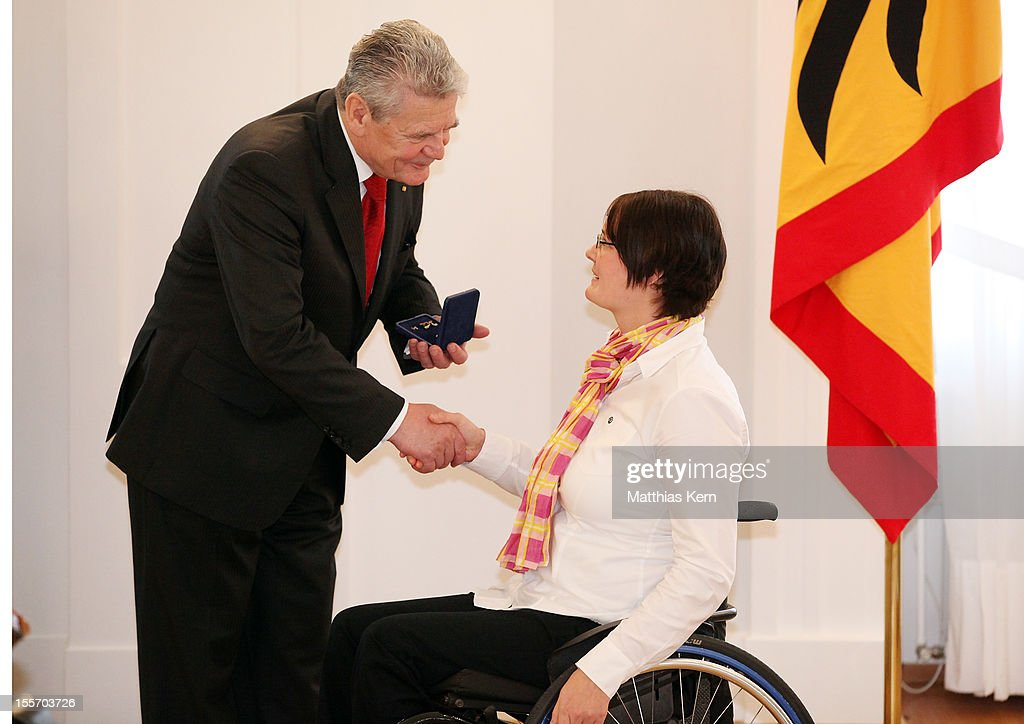 German President <a gi-track='captionPersonalityLinkClicked' href=/galleries/search?phrase=Joachim+Gauck&family=editorial&specificpeople=2077888 ng-click='$event.stopPropagation()'>Joachim Gauck</a> (L) awards Germany's silver medalist of the woman's javelin throw Marie Braemer Skowronek (R) the Silbernes Lorbeerblatt during the 'Silbernes Lorbeerblatt Award Ceremony' at Schloss Bellevue on November 7, 2012 in Berlin, Germany.