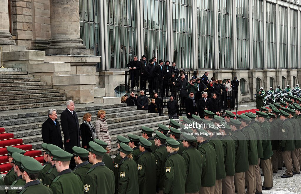 German President Joachim Gauck, Bavarian state governor Horst Seehofer, Daniela Schadt and Karin Seehofer stand in front of a guard of honour during his inaugural official visit to Bavaria on February 19, 2013 in Munich, Germany. Following his visit to the Bavarian State Chancellery President Gauck's schedule includes visits to the German Aerospace Center in Oberpfaffenhofen and a panel discussion with students at the university of Regensburg.