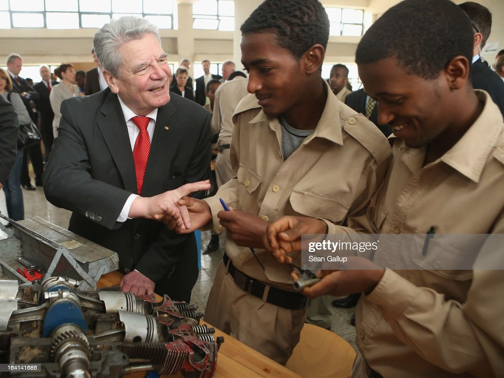 German President <a gi-track='captionPersonalityLinkClicked' href=/galleries/search?phrase=Joachim+Gauck&family=editorial&specificpeople=2077888 ng-click='$event.stopPropagation()'>Joachim Gauck</a> chats with students in the automotive technology class at the AA Tegbare-id Polytechnic College during a visit on March 20, 2013 in Addis Ababa, Ethiopia. The AA Tegbare-id Polytechnic College is supported by Germany's KFW Development Bank and the GEZ as well as the Italian government. President Gauck and First Lady Daniela Schadt are in Ethiopia on the last of a four-day state visit.