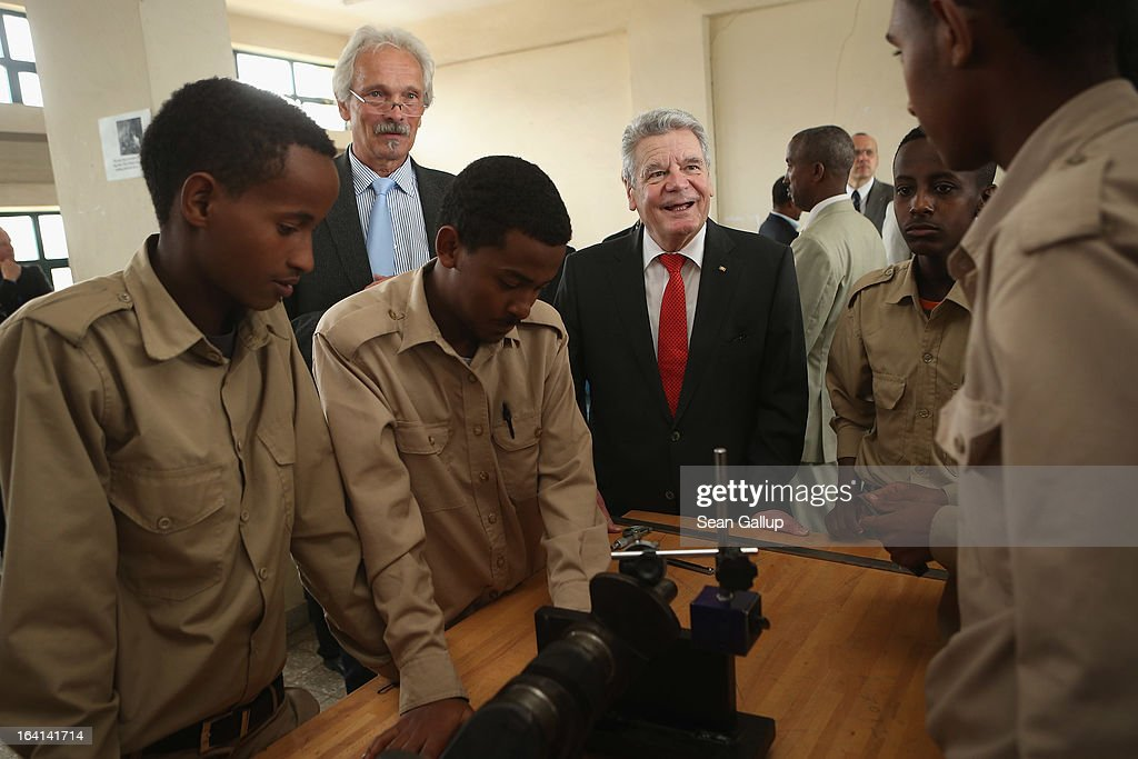 German President Joachim Gauck chats with students in the automotive technology class at the AA Tegbare-id Polytechnic College during a visit on March 20, 2013 in Addis Ababa, Ethiopia. The AA Tegbare-id Polytechnic College is supported by Germany's KFW Development Bank and the GEZ as well as the Italian government. President Gauck and First Lady Daniela Schadt are in Ethiopia on the last of a four-day state visit.